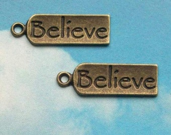 10 'Believe' charms, long tag style, antiqued bronze, 21mm, SALE
