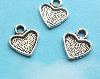 20 small textured heart charms, silver tone, 11mm