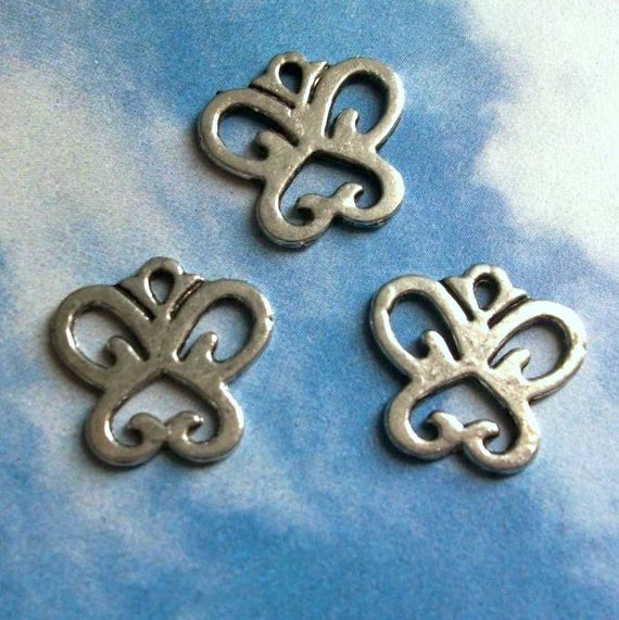 6 curvy deco butterfly charms, silver tone, 15mm