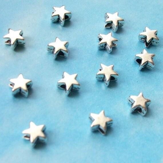 50 very tiny star beads, smooth/plain, shiny silver tone, 5mm