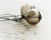 Chocolate brown handblown hollow glass and gunmetal earrings - flight