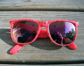 Eighties Sun Glasses - Neon Pink Plastic with Black Speckles and Irridescent Sheen on Lenses