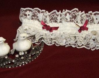Brides wedding garter in lace and silk
