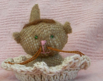 Jean-Luc le petite kitten in an organic cotton crochet basket