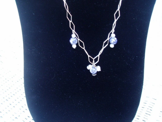Porcelain and Sterling Silver /necklace reduced was 35.00 now 30.00