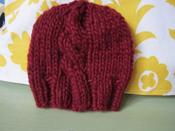Singular sensation - Red hand knit baby had with single cable