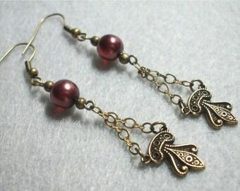 Fleur De Lis Charm Earrings in Antique Brass Gold
