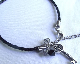 Bracelet Key braided leather black with silver crystals