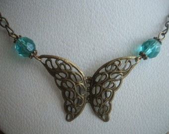 Flights of Fancy Antique gold butterfly necklace