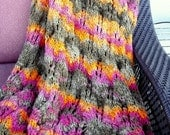Desert Sunset Blanket/Throw in browns, orange, and pink thick and decorative in fir cone lace pattern