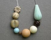 last one - pied a terre necklace - vintage lucite