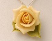Yellow rose on a sterling silver necklace
