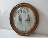 hand embroidery framed with convex glass- two women