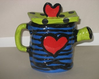 blue and lime coil teapot with red heart