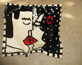 large black, white and red kiss platter