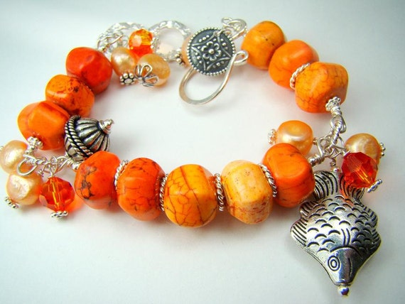 RESERVED...Tangerine...coral with freshwater pearls bracelet