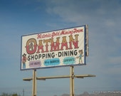 Oatman sign.  Matted color photograph.