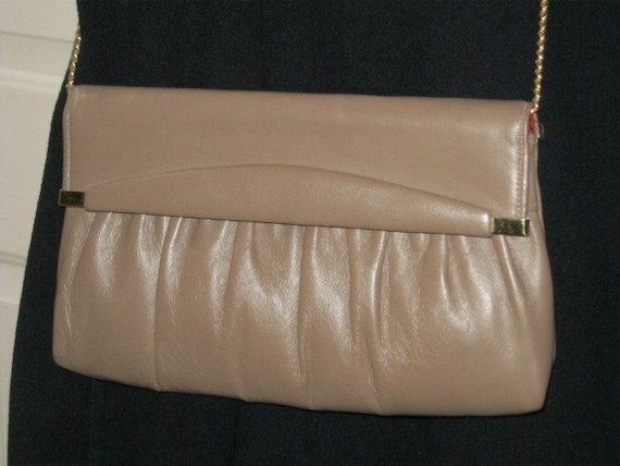 Small taupe leather flap bag with long goldtone chain strap