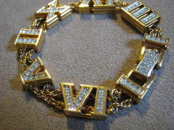 Unique and perfect Swarovski goldtone bracelet with Roman numeral in clear crystal 7 inches long