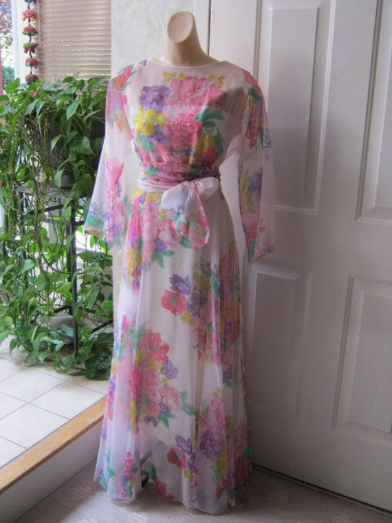 Romantic floating ankle length gown with pastel flower bouquets and sheer sleeves size 14