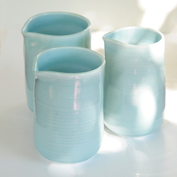 Set of 3 Wheel Thrown Porcelain handle-less pitchers with blue delicate glaze