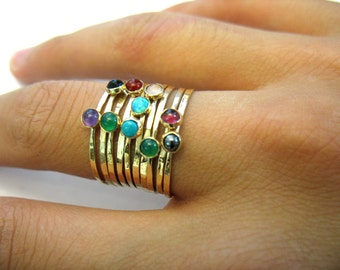 The Rainbow Ring - Stacking together hammered gold rings with semi-precious stones