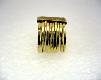Ten gold rings hammered and held by a gold belt-The treat ring