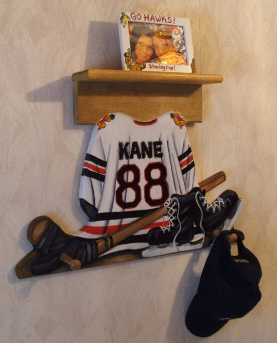 custom hockey jersey wall hanging with shelf and 3 pegs. Black Bedroom Furniture Sets. Home Design Ideas