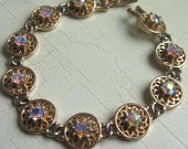 Vintage Rhinestone Bracelet Signed Coro Filigree Worked Gold Tone Metal
