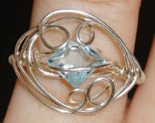 AAA Blue Topaz Princess Cut Ring... size 7 1/4
