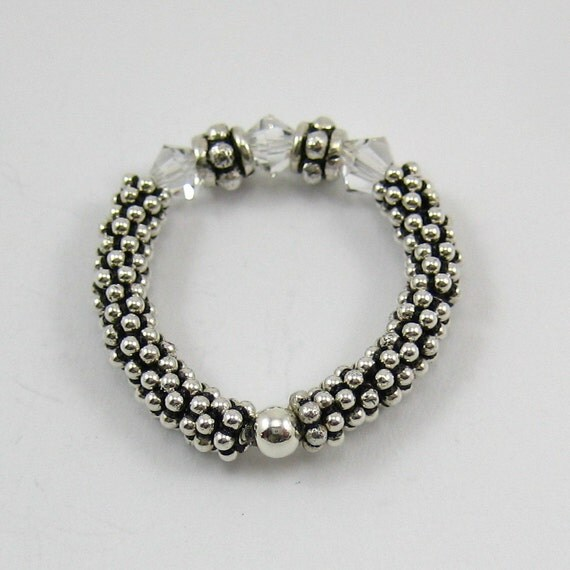 1 sterling silver stretch ring with swarovski crystals