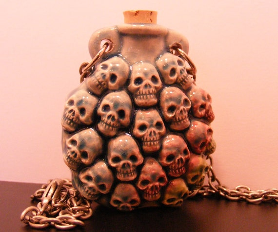 Pile of Skulls-Ceramic Jar Collection-blue, with silver chain, 27 inches