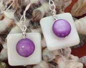 Earrings mother of pearl wte flat sq layered with purple puffed coin pierced