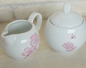 Hand painted porcelain cream and sugar set with spring cherry blossoms