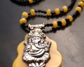 Butter scotch amber elephant pendant with onyx necklace
