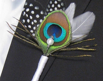 Peacock boutonniere with black polka dots and white feathers - Cosmopolitan Affair