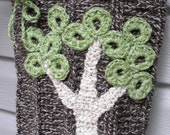 The Giving Tree, a crochet wool handbag with OOAK tree detail and polka dot lining, ready to ship.