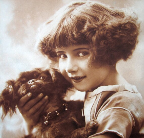 Layaway for Jannette  -  Vintage toy dog / pekingese dog with girl photo postcard, ca 1920  -  please do not buy unless you're Jannette.