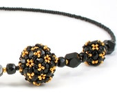 Handcrafted Black and Gold Beaded Necklace