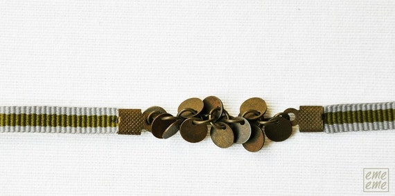 Bracelet Antique gold-plated brass charms and grey and green ribbon