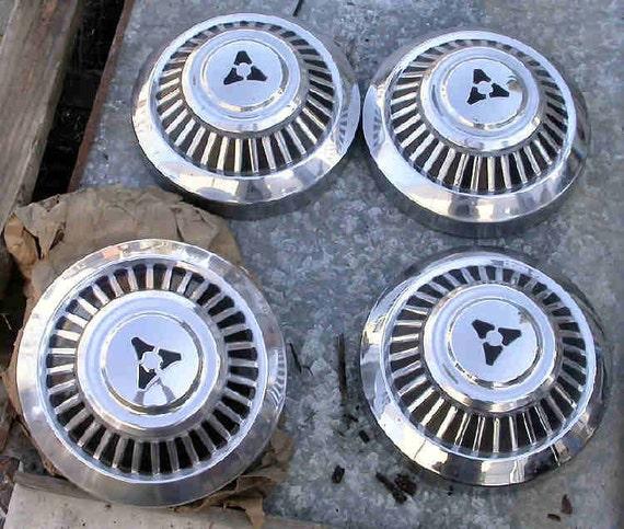 vintage chrysler wheel center caps, NOS found art, vintage hubcaps, set of 4