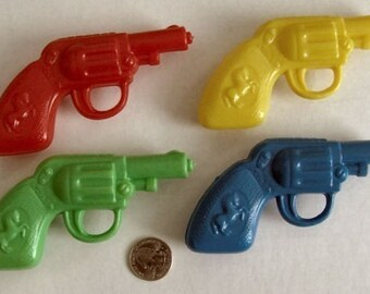 4- 1960-70s Soft Plastic Cowboy Six-Shooter Squirt Guns