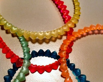 FIVE 1940-50s Linked Heart Rubber Bracelets from Carnivals
