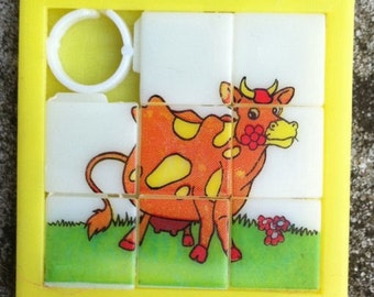 1960s-70s Plastic Two Inch Slider Puzzle COW