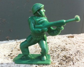 Vintage 1950s Army Man in Large Puffy Style Charging with Bowlegs
