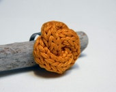 Tangerine knitted and knotted cotton yarn ring, yarn jewelry, fiber jewelry, nautical knot.