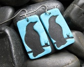 Turquoise earrings with black crow design, handmade jewelry by theshagbag on Etsy