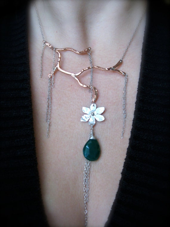 Bent branch in Copper, streams of sterling, hand made sterling blossom with faceted emerald green chalcedony drop