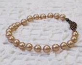 SALE Hand-knotted Swarovski Pearl Bracelet Vintage Gold and Antiqued Brass