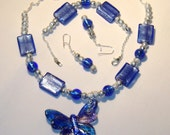 Butterfly in flight JEWELRY SET, necklace with butterfly pendant, bracelet, dangle earrings, blue and silver colors, part chain, textured silver color beads, glass beads, has glass butterfly pendant